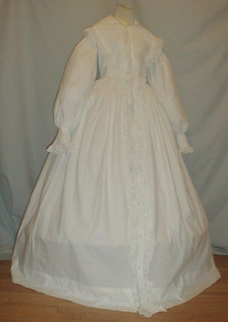 Ca.1860 whitework cotton wrapper or morning robe. Button front and drawstring at front waist. Deaccessioned from the Rochester Historical Society Museum. Ebay seller Fiddybee.